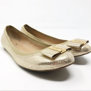 Kate spade gold flats with bows
